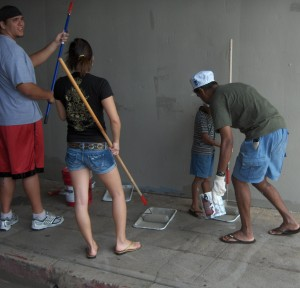 Before:  Volunteers help clean the underpass on University Avenue.