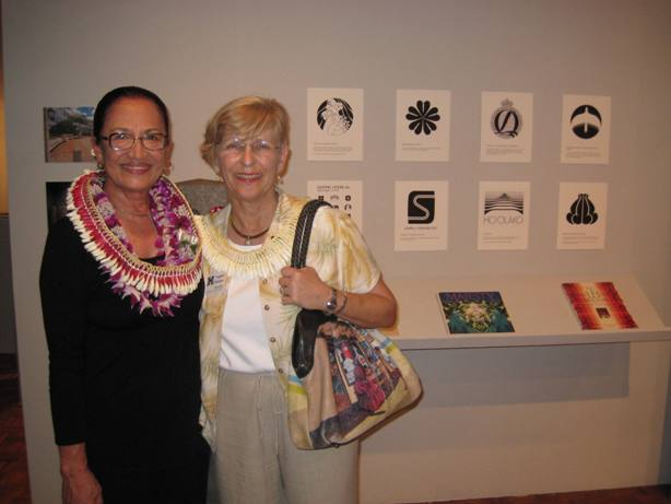 Graphic designer Momi Cazimero and Chancellor Virginia Hinshaw.