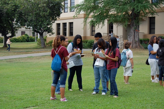 Waipahu Intermediate students put their heads together in front of Crawford Hall.