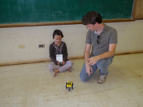 Under the guidance of Italian graduate student Luca Invernizzi, a young girl controls the remotely operated vehicle that she just built.