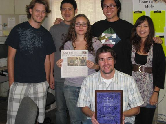"Ka Leo O Hawai'i editor Mark Brislin, seated and holding the 2010 Pa'i Award plaque for ""Best School Newspaper,"" with (from left) comics editor and next year's editor-in-chief Will Caron, managing editor Ty Tanji, design editor Sarah Wright, photo editor Brian Tseng and page designer Kaori Saitoh."