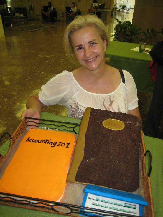 "Dawn Skaggs and her double cake entry, which won ""Best Use of Chocolate"" honors."