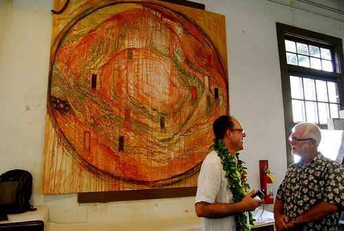 The sons of fresco muralists: Minguell & UH Mānoa religion professor John Charlot stand in front of Minguell's mural, which was unveiled at a cultural fiesta on April 9.