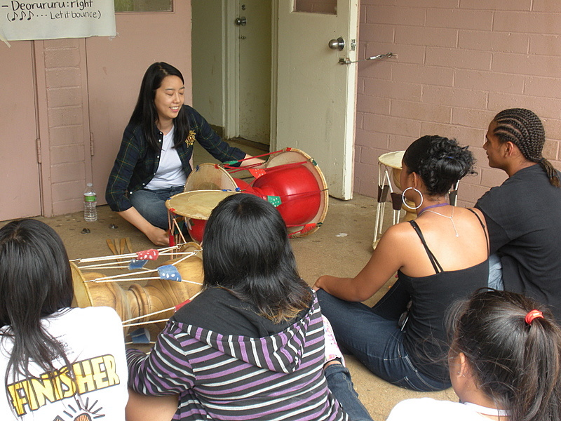 Ethnomusicology graduate student Ri Choi teaches the rhythmic patterns of Korean janggu drumming at Farrington High.