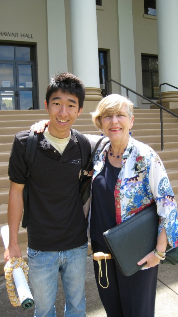 ASUH President Andrew Itsuno is congratulated by Chancellor Virginia Hinshaw.