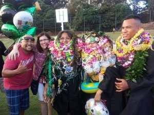 "CPIS graduates Jocelyn Howard (center) and Kathy Jetnil-Kijiner with John ""Niko"" Pātū (far right, graduating in August) with Keola Diaz (CPIS MA 2012) and Julie Walsh at spring commencement. Photo by Tamera Heine."