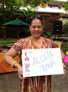 Micky Huihui, one of the event coordinators, with her poster. Photo by Malia Nobrega-Olivera.
