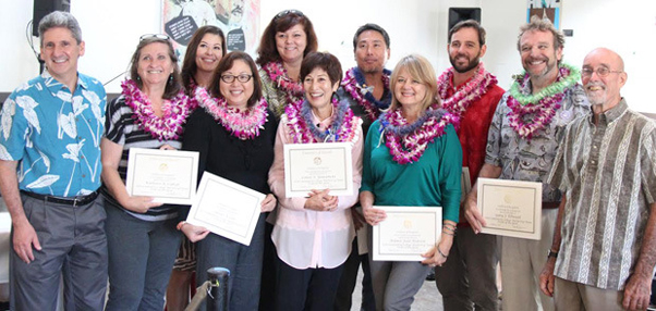 UH President David Lassner, far left, and UH Board Chair Randolph G. Moore, far right, presented from left, Kathleen Cabral, Billie Takaki Lueder, Susan Lee, Stephanie Kim, Louise Yamamoto, Paul Sakamoto, Bonnie Beatson, Thatcher Moats and Gary Ellwood their UH Team of the Year award.