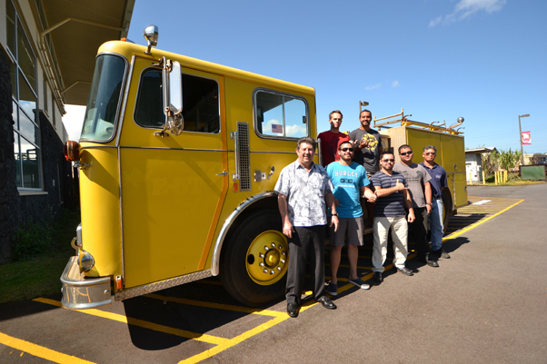 Hawai'i Community College Fire Science students and instructors from the Fire Science and Diesel Mechanics programs stand with the fire engine donated recently by the Honolulu Fire Department. Back row: Matthew Winters, left, and Jacob Smith. Front row, left to right: Fire Science Instructor Jack Minassian, Kawai Ronia, Jayce Ah Heong, Michael Rangasan, and Diesel Mechanics Instructor Mitchell Soares.