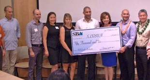 XLR8UH receives U.S. Small Business Administration $50,000 check.