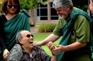 Richard Kekuni Blaisdell surrounded by his daughter Nalani Blaisdell and greeted by Kalani Brady, in the John A. Burn School of Medicine's Native Hawaiian Healing Garden.