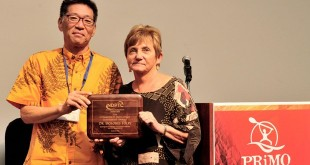 Dolores Foley receives the National Disaster Preparedness Training Center Community Resilience Award from NDPTC Executive Director Karl Kim.