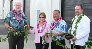Brian Taylor, University of Hawaiʻi at Mānoa School of Ocean and Earth Science and Technology Dean; Senator Lorraine Inouye; Darrell Young, Hawaiʻi Department of Transportation Harbors Division Deputy Director; Kahu Hailama Farden perform the ceremonial untying of the maile lei at the new facility at Pier 35. (photo from the Hawaiʻi Department of Transportation)