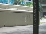 Tags on the wall and lamp post that line the walkway of Post and Sakamaki.