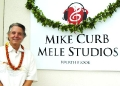 Mike Curb in front of the MELE studios named after him