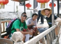 Three UH basketball players in Chinese boat