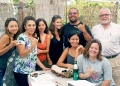 Seven students with Spanish translation class instructor at outdoor table