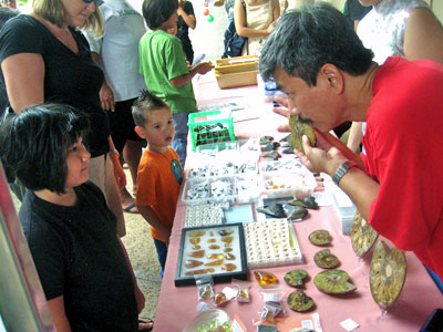 exhibitor speaks to a child