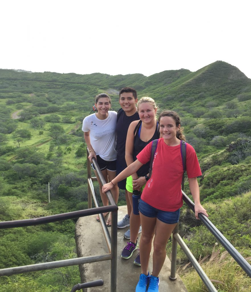 4 ASH students with the center of the Diamond Head crater below