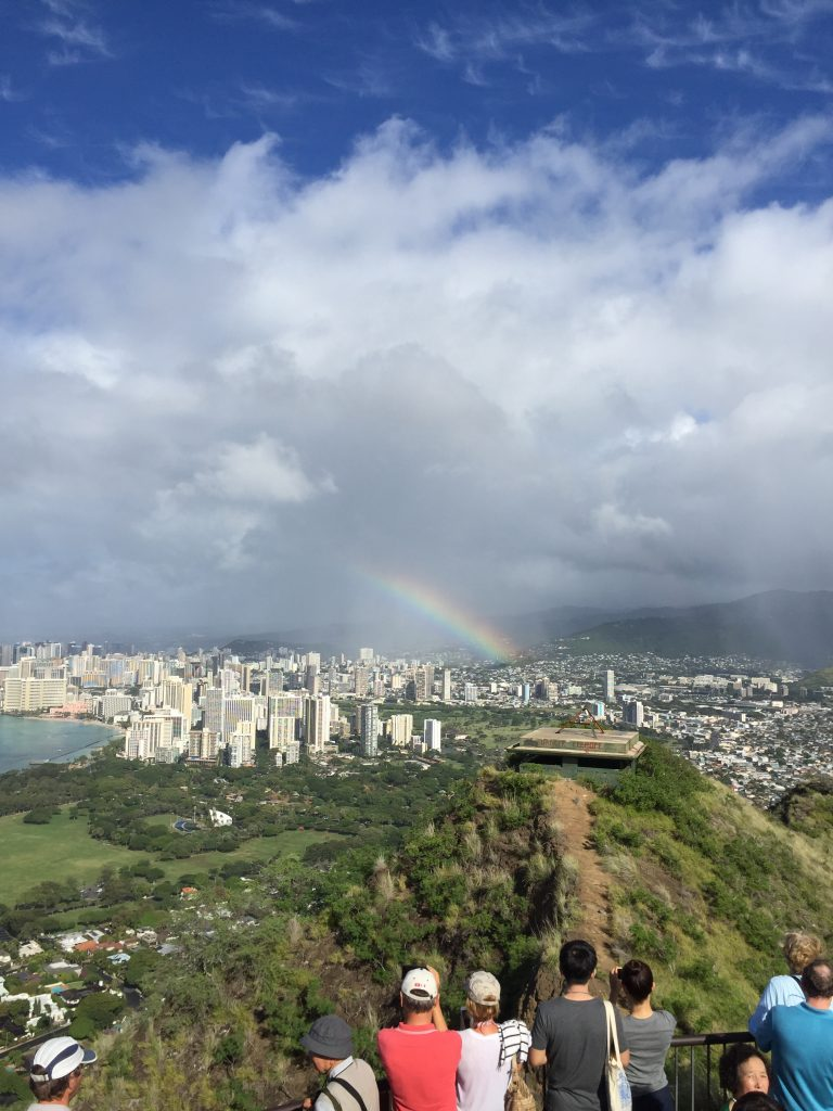A view of Waikiki with a rainbow in the sky