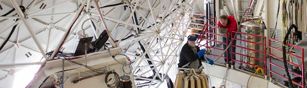 scientists at work on large geodesic dome