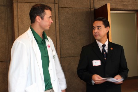 Med student Zachary Thielen conversing with Representative Joey Manahan