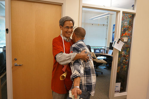 Dr. David Horio gives Dr. Haning a hug outside an office in the Medical Education Building at JABSOM Kaka`ako.