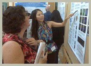 Aileen Li, presenting a research poster.