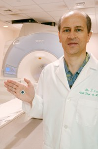 Dr. Thomas Ernst, JABSOM neuroscientist, with the motion correction microchip at The Queen's Medical Center. Photo courtesy The Queen's Medical Center.