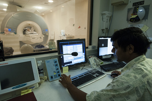 The MRI technology in action at The Queen's Medical Center/JABSOM Neuroscience Center. Photo courtesy of The Queen's Medical Center.