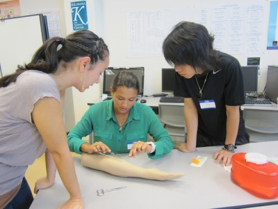 Suture workshop engages aspiring MDs in Hilo.