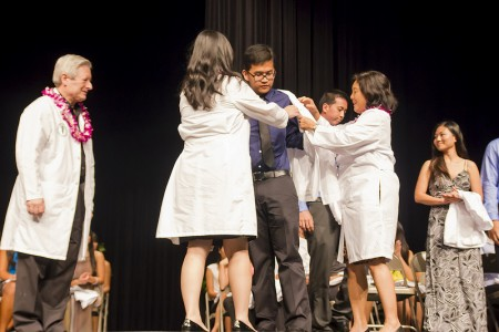 Kyan Agbayani of Aiea gets his White Coat