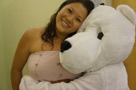 Wendy Shimamoto in the Dean's Office gets a hug from the Valentine's Bear.
