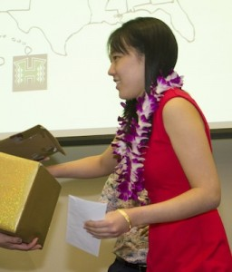 Jodi Kagihara holds her sealed envelope and grabs that of the next student's name to be called.