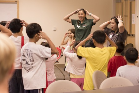 "Medical student Yuree Nam and Dr. Jill Omori sing and dance to ""head, shoulders, knees and toes"" with the keiki."