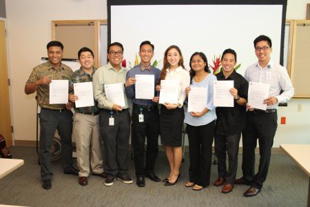 They're pictured holding their acceptance letters into JABSOM. (The rest of the class of 66 members arrives on the Kaka`ako campus for Orientation on July 14, 2014.)