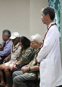 Dr. Richard Arakaki, JABSOM Professor of Medicine, stands with participants in the Hawai`i study.