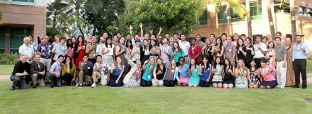 A shaka from Residents and Fellows at their 2014 Beginning of Year Social at JABSOM.