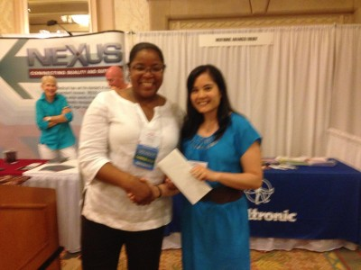 Dr. Kuba is presented the Poster Award by the WOA President  WOA President Valerae O. Lewis, M.D.